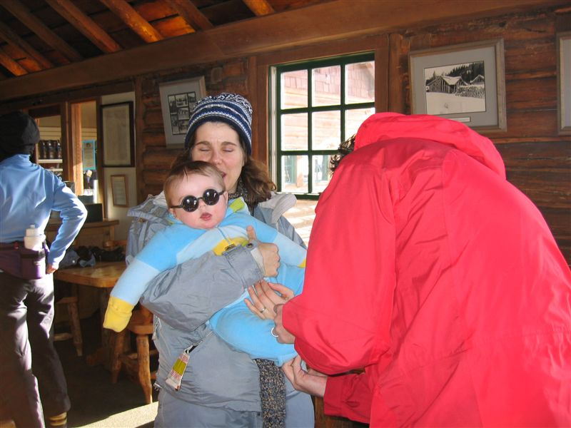 Benjamin sporting his very cool John Lennon glasses while Mom and Dad bundle him up for the big snoeshoe adventure