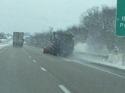 Our goal, once we hid the bad weather in Kansas and beyond, was to stay behing the snowplows (our heros).  This one is working on the shoulder of the road now.