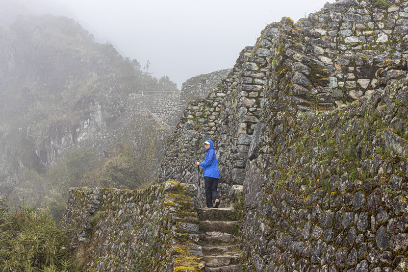 Susan hiking up to the Sayacmarca Ruins