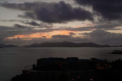 The view of a dawn-twilight sky.  St. John's is in the distance, and the Wyndham resort is the silhouette below.