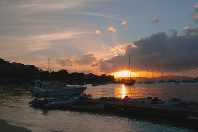 Sunset from Cruz Bay over the harbor and St. Thomas in the distance