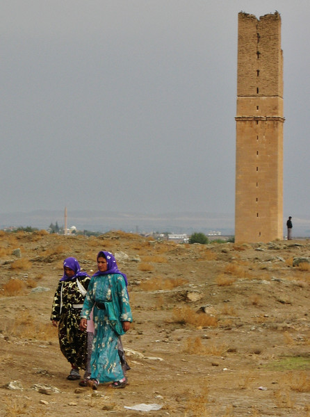 Traditional colourful dressed women, Archaeological site, The grand mosque of Harran, S.E. of Sanliurfa near the border of Syria