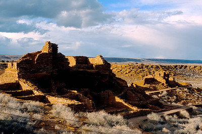 Wupatki ruins in northern Arizona. The ruins, rocks and sky appeal to me but the fence shadows in the foreground break the spell. I was tempted to edit out the shadows but such imperfections make images credible.