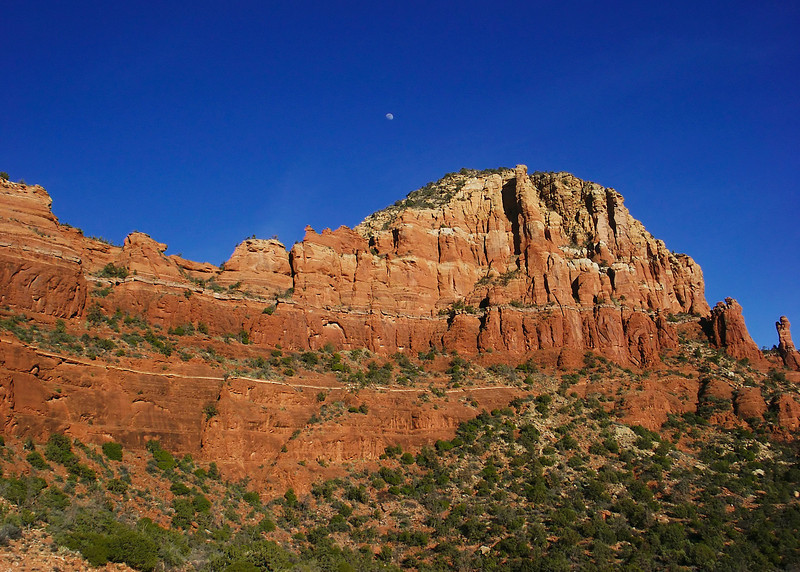 The moon over the red rocks of Sedona.