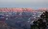 The last rays of the setting sun illuminating the top layers of the Grand Canyon.