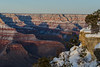 The setting sun casting shadows in the Grand Canyon.