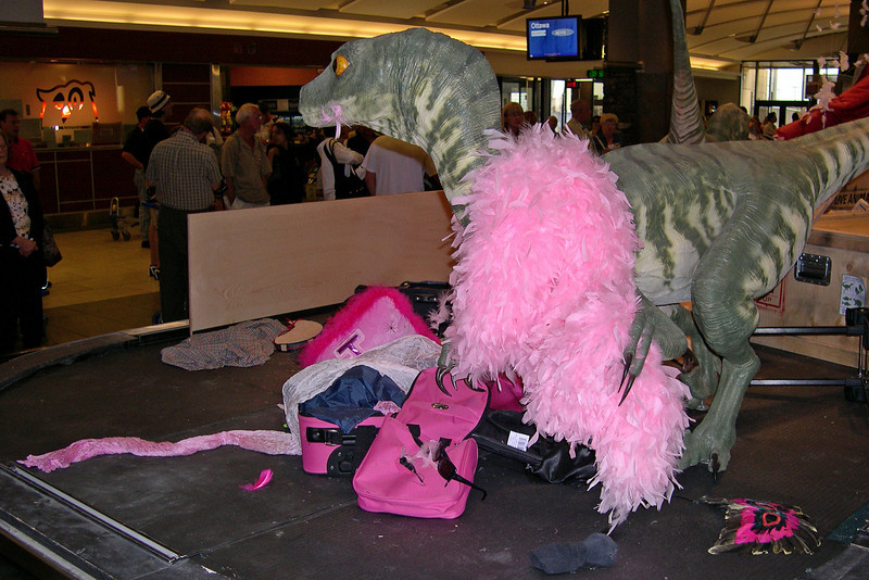 Finally an excuse for lost luggage - dinosaurs in drag!