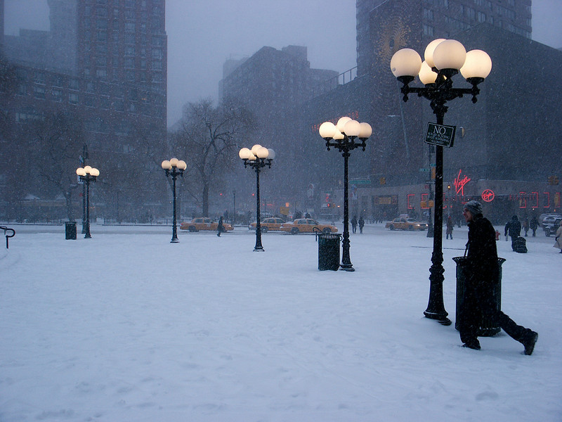 Snow falling in Union Square.