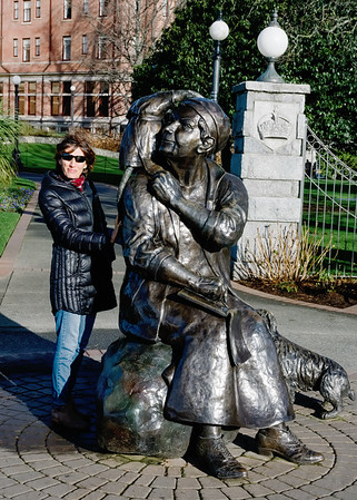 Mali beside the Emily Carr statue on the grounds of the Empress Hotel in Victoria BC.  In the 1970s I stayed in the Empress with two Edmonton friends: Bob and Carl Sullivan. In those days the Empress was a bit run down. It wasn't a dive but you could confidently check-in any day of the week without reservations. It's not like that now. On that long-ago visit, we ordered Tea and Crumpets. Room service screwed up the order and delivered three dozen crumpets: a dozen each! That's a lot of crumpets. On this trip, I wanted to sit in the Empress, order Tea and Crumpets again, and toast my now deceased friend Carl. Alas, it wasn't to be. The Empress has gone all upscale and no longer accommodates peons walking in off the street and ordering Crumpets.