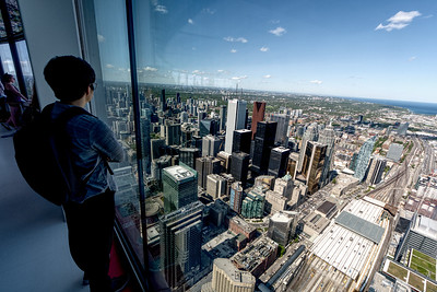 Observation decks are frequently glassed in. This is a problem for photographers. Shooting through fingerprinted nonoptical glass always degrades the view. Sometimes I just give up and include people in the foreground.