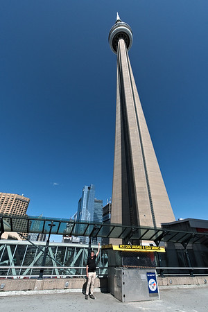 Tim pointing with the CN Tower. He's benefiting from the sliming wide angle lens edge diet.