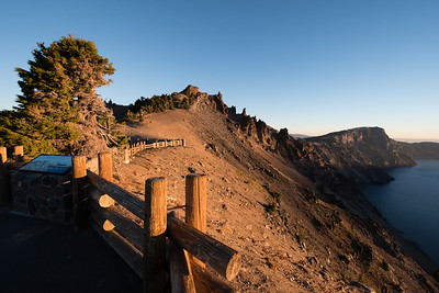 Early morning sunlight falling on the northwestern rim Crater Lake Watchman overlook.
