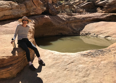 """Mali beside a """"tank pool"""" in Capitol Reef National Park."""