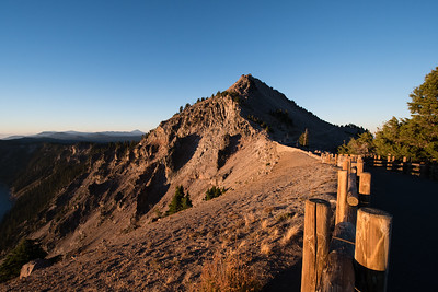 Early morning sunlight falling on the southwestern rim Crater Lake Watchman overlook. You can make out the Watchman tower on the summit of the highest peak.