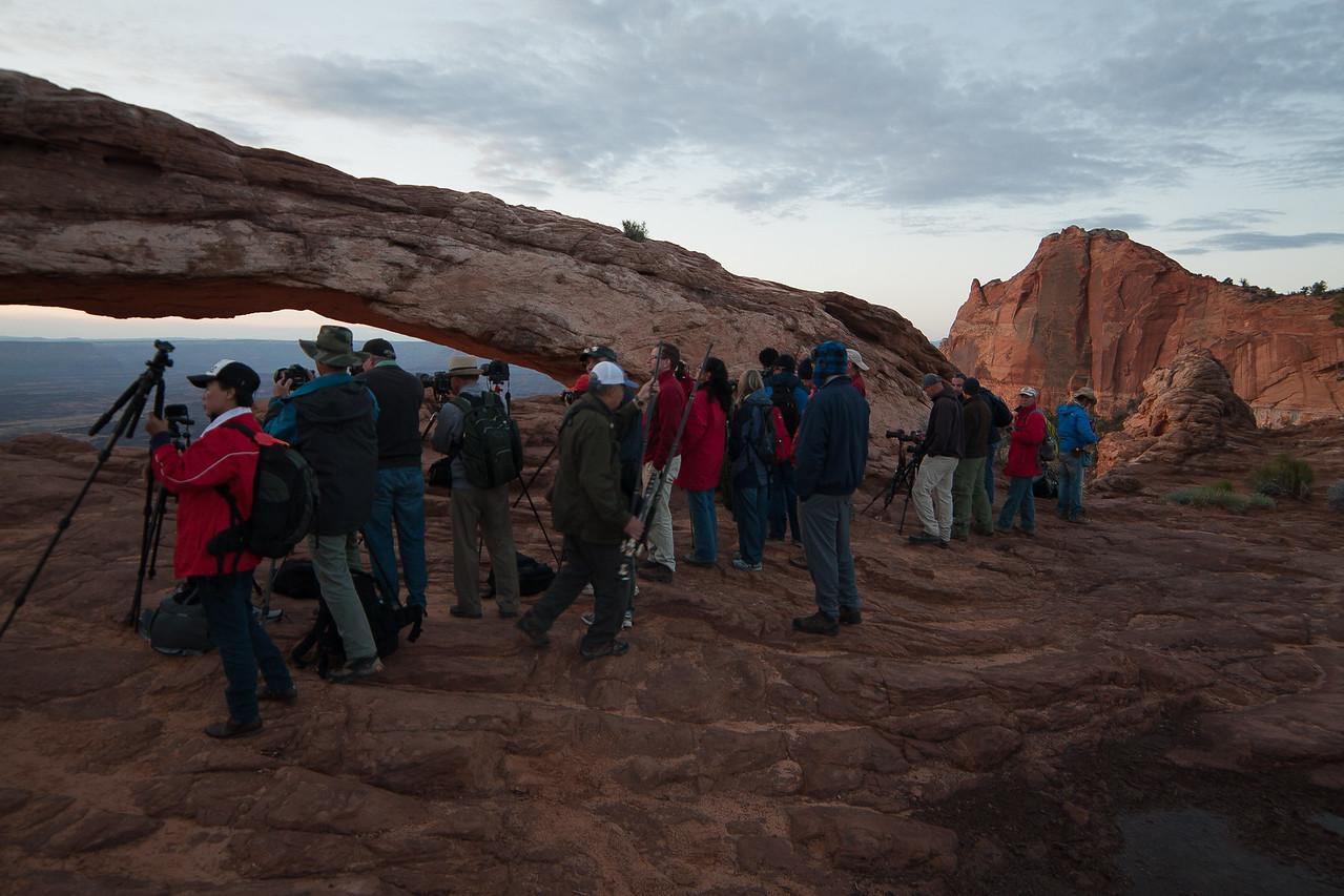 Paparazzi lining up at Mesa Arch