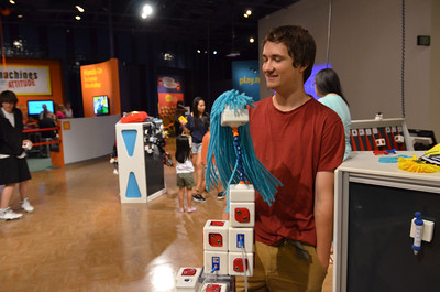 Mark with his social robot at the San Jose Tech Museum.
