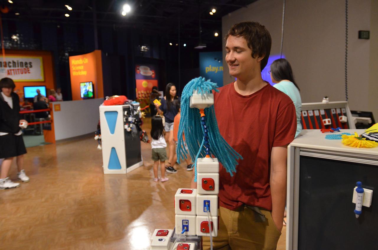 Mark with his social robot at the San Jose Tech Museum.