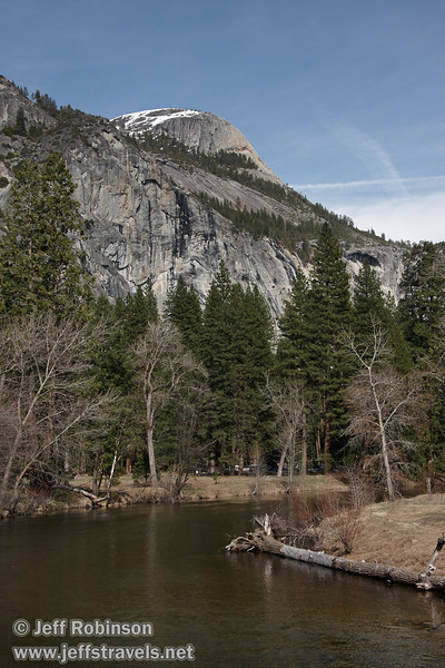 North Dome with some snow on it, with the Merced River in the foreground. Seen from the foot bridge over the Merced River between the Chapel and Lower Yosemite Fall. (3/28/10, Yosemite NP)