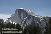 Half Dome with some snow and partly cloudy sky behind it. Seen from Cooks Meadow (3/28/10, Yosemite NP)