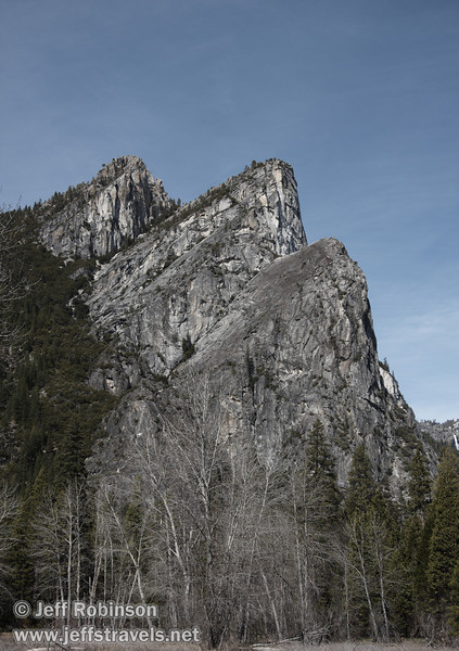 The Three Brothers with dead grass & leafless trees in foreground: Left-most is Eagle Peak, center is the Middle Brother, and right is the Lower Brother. Seen from the south side of the Merced River near a turnout (roughly south of The Three Brothers picnic area). (3/28/10, Yosemite NP)