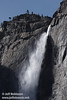 Top part of Upper Yosemite Fall against blue sky, emphasizing how far out the water sprays. Seen from near the Sentinel Bridge. (3/28/10, Yosemite NP)