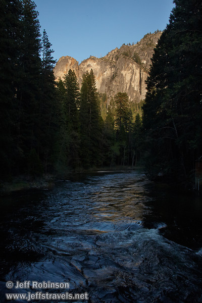 Late sun on the valley cliffs framed by the Merced River and surrounding trees in deep shade. Seen looking upstream from the Pohono Bridge. (5/15/2010, Yosemite NP)<br /> EF-S17-85mm f/4-5.6 IS USM @ 22mm f10 1/250s ISO400
