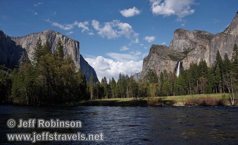 El Capitan (left) and with Bridalveil Fall and the Cathedral Rocks (right) against a partly-cloudy blue sky with trees and the Merced River in the foreground. Seen at the Valley View turnout on Northside Drive (5/15/2010, Yosemite NP)<br /> EF-S10-22mm f/3.5-4.5 USM @ 16mm f9 1/200s ISO100