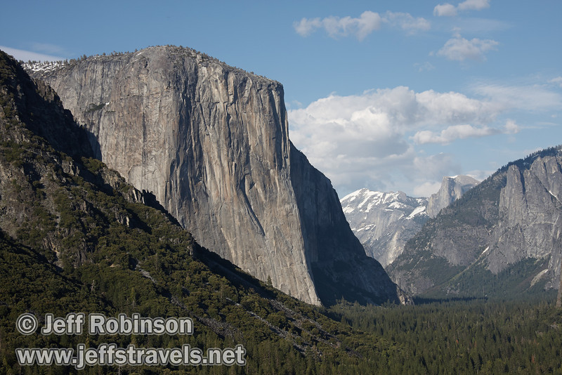 El Capitan (left), and Half Dome (distant right) against a partly cloudy sky. Seen from Tunnel View. (5/15/2010, Yosemite NP)<br /> EF-S17-85mm f/4-5.6 IS USM @ 41mm f10 1/160s ISO100