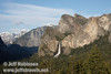 Half Dome (distant left), and Bridalveil Fall below the Cathedral Rocks (right) against a partly cloudy sky in late sun. Seen from Tunnel View. (5/15/2010, Yosemite NP)<br /> EF-S17-85mm f/4-5.6 IS USM @ 38mm f9 1/250s ISO160