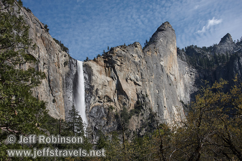 Bridalveil Fall and Leaning Tower (right) with foreground trees against blue sky dappled with clouds. Seen at the turnout on Southside Drive north of Bridalveil Fall (5/15/2010, Yosemite NP)<br /> EF-S17-85mm f/4-5.6 IS USM @ 30mm f10 1/200s ISO100