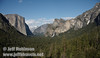 El Capitan (left), Half Dome (distant center), and Bridalveil Fall below the Cathedral Rocks (right) against a partly cloudy sky. Seen from Tunnel View. (5/15/2010, Yosemite NP)<br /> EF-S17-85mm f/4-5.6 IS USM @ 17mm f9 1/200s ISO100
