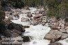 White water rushing down the boulder-strewn Merced River canyon. Seen from a turnout on El Portal Road (highway 140) (5/15/2010, Yosemite NP)<br /> EF-S17-85mm f/4-5.6 IS USM @ 59mm f11 1/250s ISO100