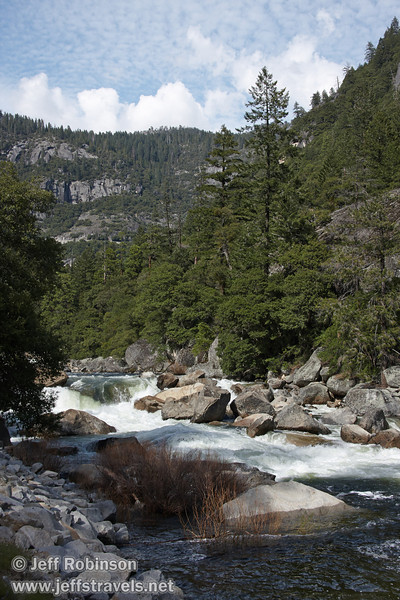 White water rapids rushing by granite boulders in the Merced River canyon with clouds and some blue sky. Seen at a turnout (the 2nd we stopped at) by the Merced River on El Portal Road (highway 140) (5/15/2010, Yosemite NP)<br /> EF-S17-85mm f/4-5.6 IS USM @ 30mm f10 1/250s ISO160