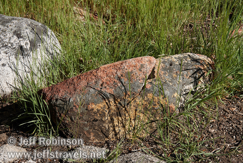Red and yellow rock against green grass.Seen by the Merced River near the the turnout on Southside Drive north of Bridalveil Fall (5/15/2010, Yosemite NP)<br /> EF-S17-85mm f/4-5.6 IS USM @ 64mm f9 1/200s ISO100