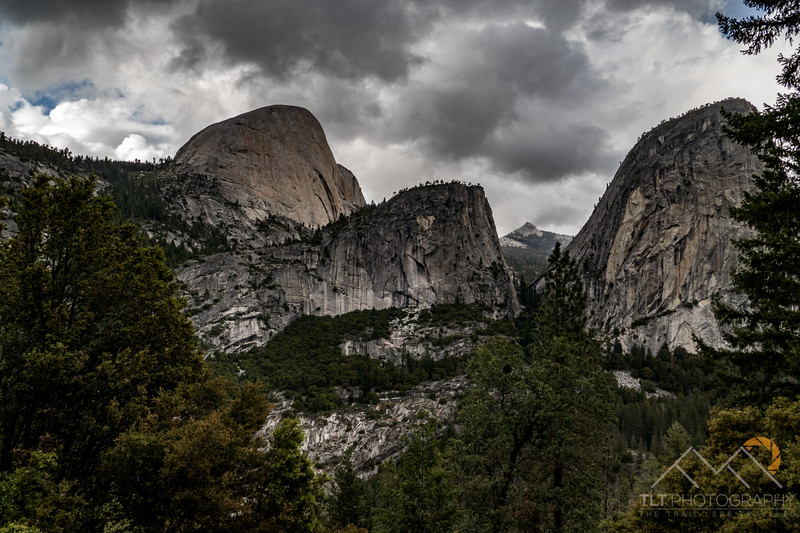 Liberty Cap in front, Half Dome in back and Mount Broderick in middle with Nevada Falls on the Merced River from John Muir Trail in Yosemite.