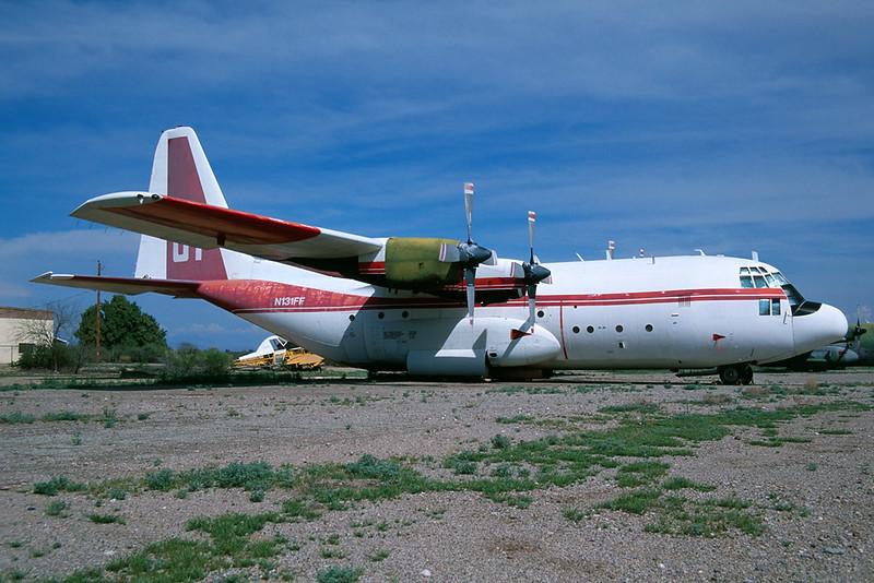 """N131FF (81) Lockheed C-130A Hercules """"Aerofirefighting Service"""" c/n 3138 Chandler-Memorial 13-03-04 (35mm slide)"""