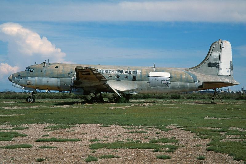 "N44915 Douglas DC-4 Q-10-DC ""Biegert Aviation"" c/n 10854 Chandler-Memorial 13-03-04 (35mm slide)"