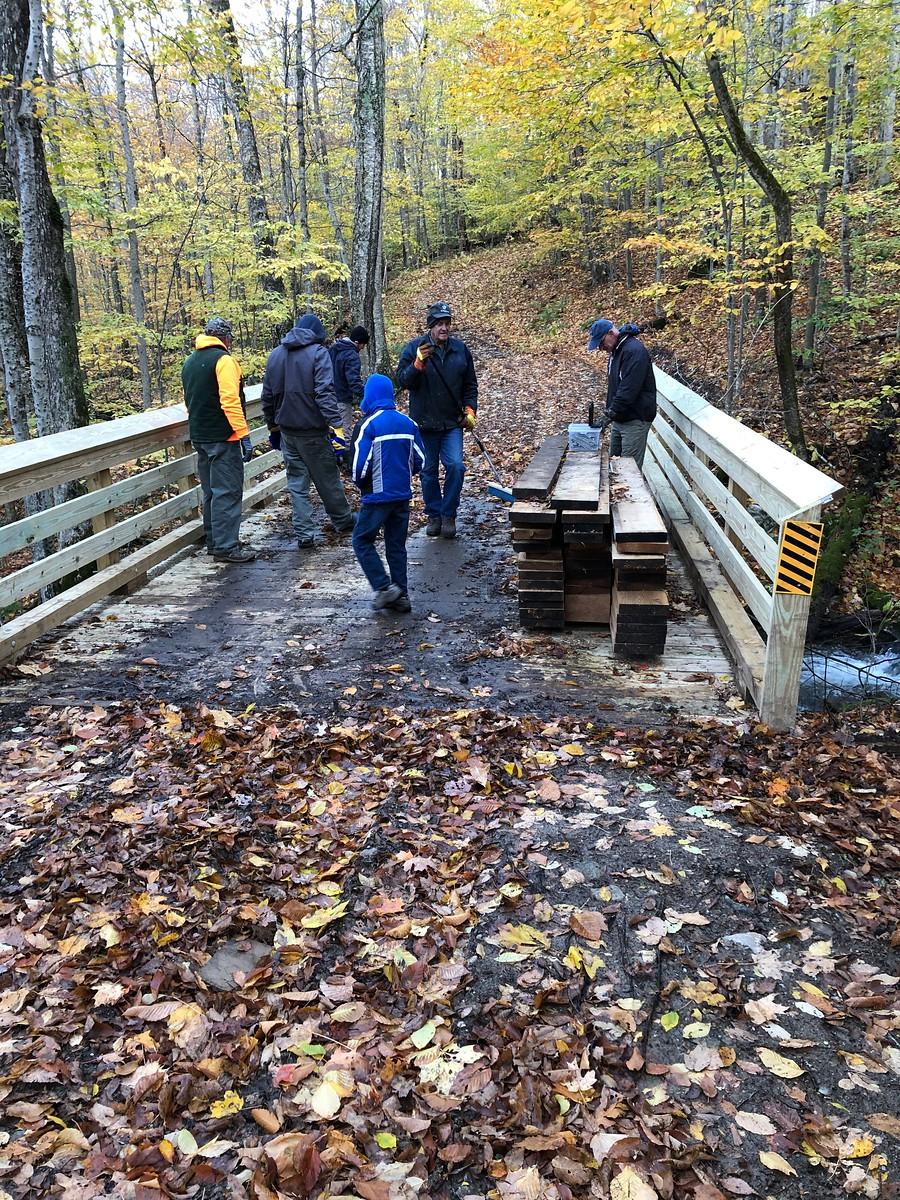 Volunteers working on a bridge