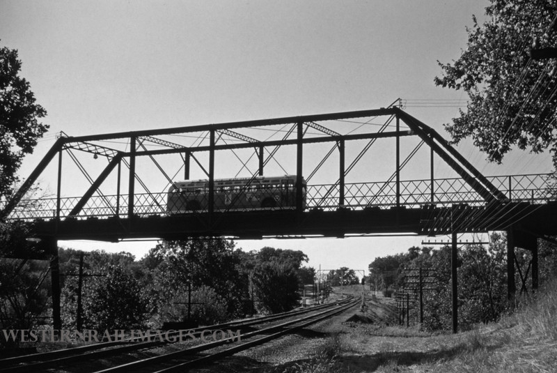 PSCO 169 - Sep 24 1956 - ppsco bus EB crossing Mopac westbound line at Edgebrook Maplewood MO