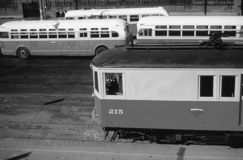 PSCO 28 - Oct 3 1954 - rail grinder 215 & busses 3090 4012 - St Louis MO