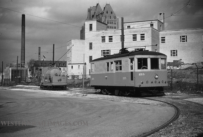 PSCO 74 - Mar 3 1955 - rail grinder 215 & weed sprayer 60 at spring & park material yard St  Louis