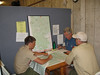 Jake Theis and Tom Kiser getting the details of our trek from the Philmont Logistics staff