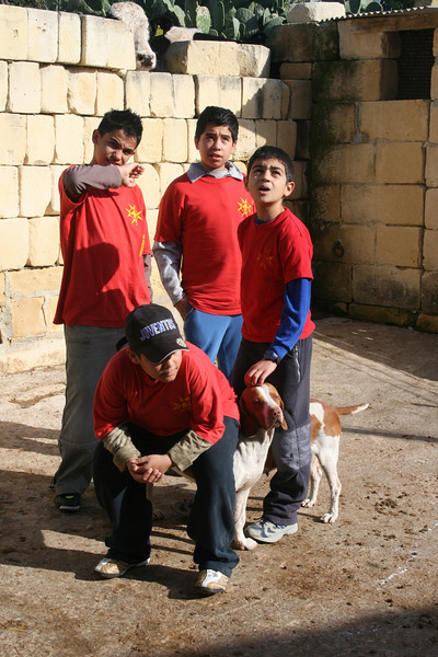 Some of the Xaghra Scouts....yes the guy in front is trying to sit on that poor dog!