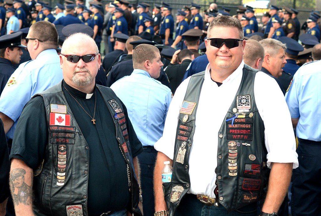 . Rev. Deacon Glenn Morrison, a retired Waterfor Dispatcher, left, and Mike Kinieper of Howell attending the funeral of Michigan State trooper Chad Wolf, 38 of Fenton, a motorcycle trooper was hit and dragged northbound on  I-75 in Independence Township Friday, later dying from his injuries.  Tuesday, September 1, 2015.  Tim Thompson-The Oakland Press