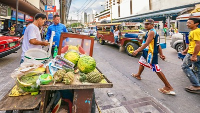 Selling fresh fruit on a busy street in Manila.