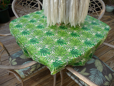 philodendron/tropical tablecloth (note palm tree chairs)