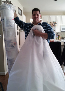 the proud bride with a frostcloth gown!