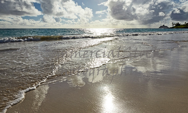 Exotic tropical island beach and surf at sunrise