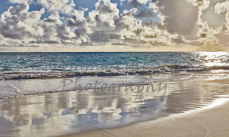 Tropical island beach sunrise and surf shoreline