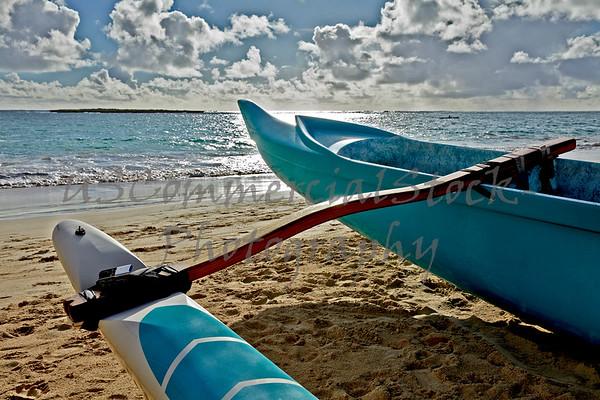 Outrigger canoe on sandy beach in Hawaii at sunrise closeup
